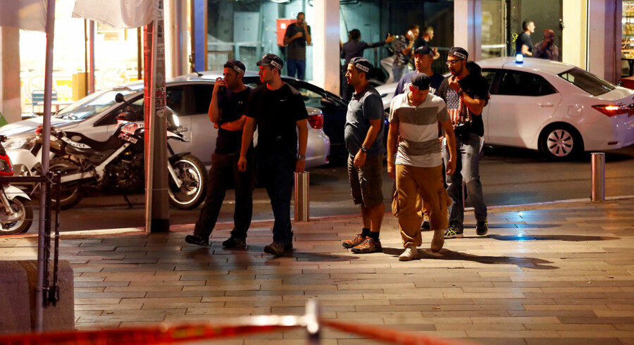 Israeli security personnel secure the area where a shooting attack took place in the center of Tel Aviv June 8, 2016.