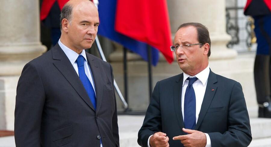 Den græske premierminister (tv) har i de sidste par dage har været på charmeoffensiv for at forsikre EU-partnerne om, at Grækenland nu omsider er i gang med at levere den sanering af økonomien