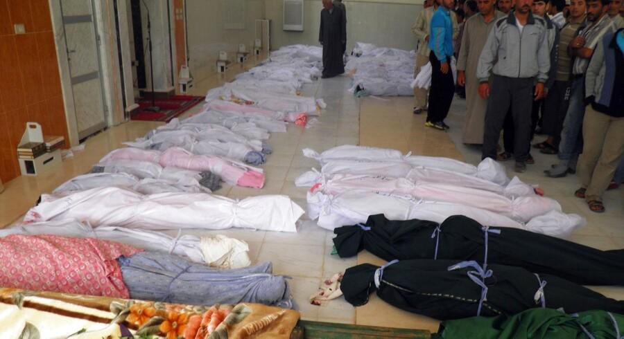 Det var syriske regeringsstyrker og den frygtede Shabbiha-milits stod bag drabene på 108 civile, heraf halvdelen børn i byen Houla, fastslår en FN-rapport.