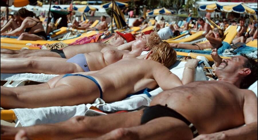 Svensk-produceret armbånd skal hjælpe de solglade mod at tilbringe for meget tid i solen, så de undgår solskoldning, modermærkekræft og hudkræft. (Foto: ANNETT BRUHN/Scanpix 2012)