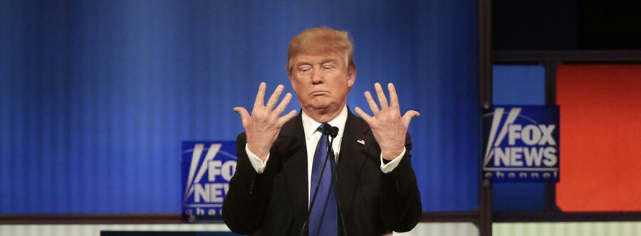 Republican U.S. presidential candidate Donald Trump shows off the size of his hands as Fox News Channel moderators Brett Baier (L) and Megyn Kelly (R) look on at the U.S. Republican presidential candidates debate in Detroit, Michigan, March 3, 2016. REUTERS/Rebecca Cook