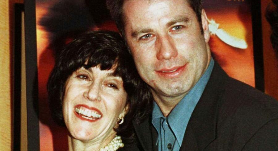 Nora Ephron med filmstjernen John Travolta i 1996.