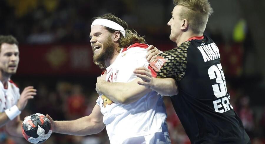 Mikkel Hansen i aktion i EM-kampen mod Tyskland 27 januar 2016 i Wroclaw, Polen. Nu er netop tyskernes EM-sejr skyld i, at det bliver op ad bakke for Danmark at kvalificere sig til OL.