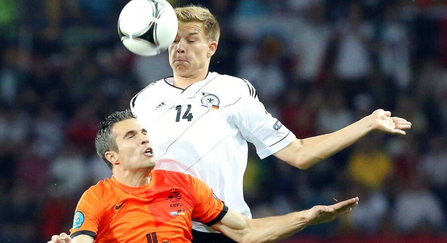 epa03263508 Germany's Holger Badstuber (up) in action against Dutch Robin van Persie (bottom) during the Group B preliminary round match of the UEFA EURO 2012 between the Netherlands and Germany in Kharkiv, Ukraine, 13 June 2012. EPA/LINDESY PARNABY UEFA Terms and Conditions apply http://www.epa.eu/downloads/UEFA-EURO2012-TCS.pdf