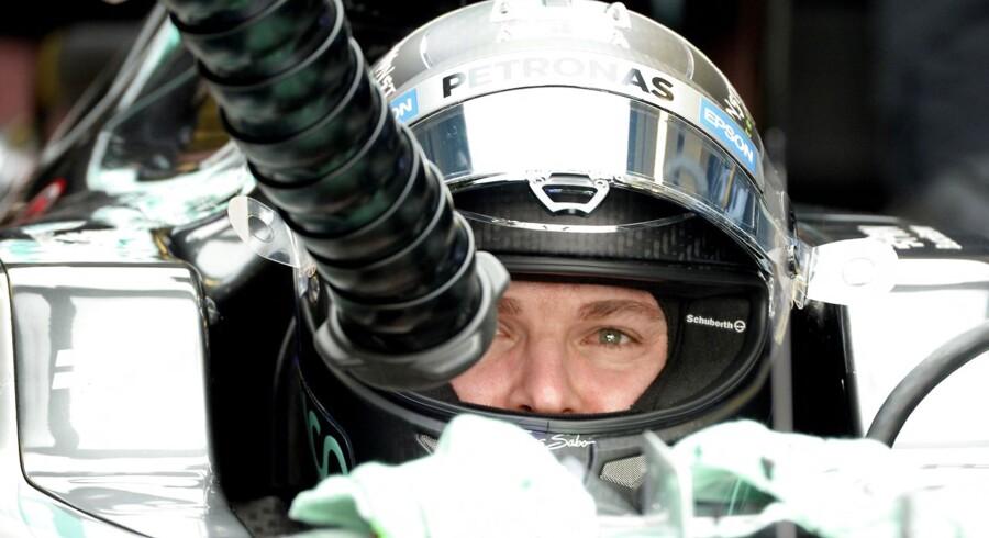 Mercedes AMG Petronas F1 Team's German driver Nico Rosberg sits in the pit during the third practice session at the Yas Marina circuit in Abu Dhabi November 28, 2015 ahead of the Abu Dhabi Formula One Grand Prix. AFP PHOTO / TOM GANDOLFINI