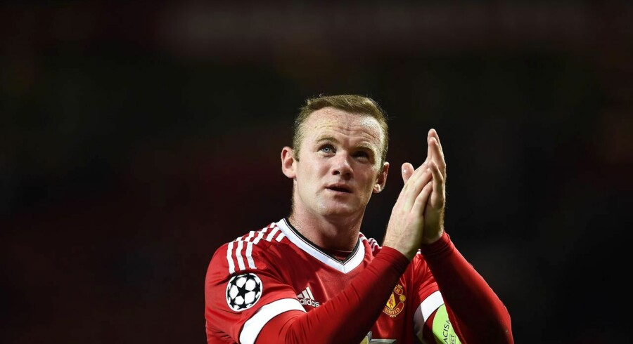 (FILES) A file photo taken on September 30, 2015, shows Manchester United's English forward Wayne Rooney as he applauds the fans following the UEFA Champions League Group B football match between Manchester United and VfL Wolfsburg at Old Trafford in Manchester, north west England. Manchester United won the match 2-1. Ahead of his 30th birthday on October 24, 2015, the view of Wayne Rooney as a player whose career, though hugely successful, never quite fulfilled its early promise is being quietly reappraised. AFP PHOTO / PAUL ELLIS