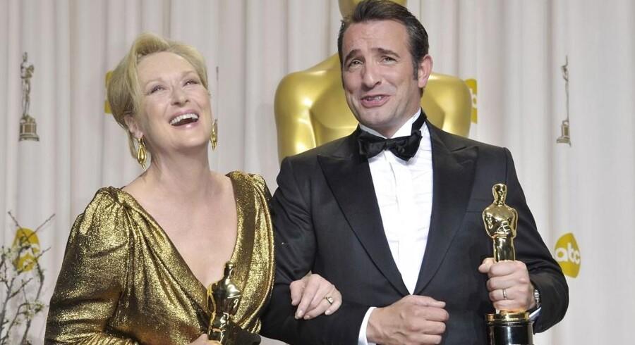 Kvinderne er synlige på den røde løber til Oscar-festen som her Meryl Streep og franske Jean Dujardin, men deres rolle i filmene er stadig kun at være tilbehør til mændene, siger amerikansk feminist.