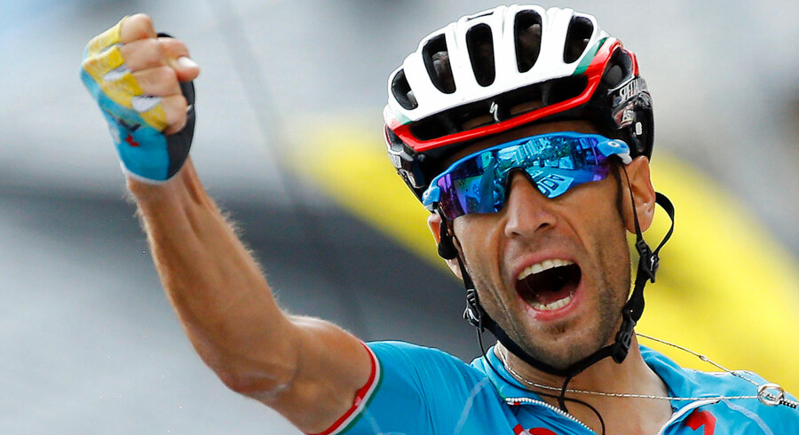 Astana rider Vincenzo Nibali of Italy celebrates as he crosses the finish line to win the 138-km (85.74 miles) 19th stage of the 102nd Tour de France cycling race from Saint-Jean-de-Maurienne to La Toussuire-Les Sybelles in the French Alps mountains, France, July 24, 2015. REUTERS/Stefano Rellandini