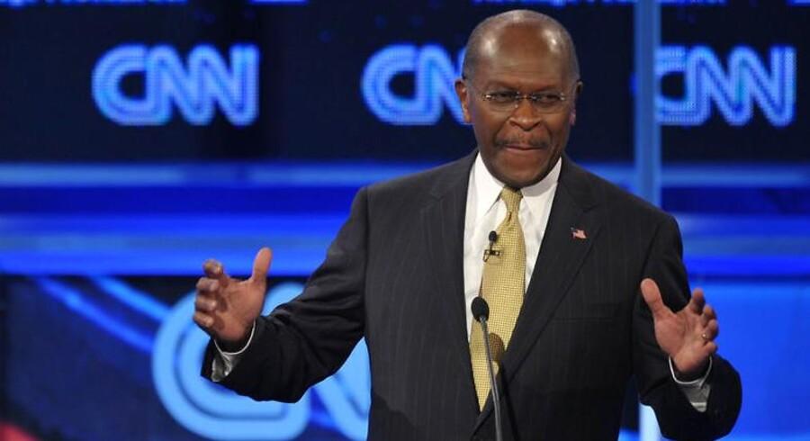 Herman Cain bliver ved med at løbe ind i problemer, men nu er det slut. Han suspenderer sin kampagne for at blive USAs næste præsident.