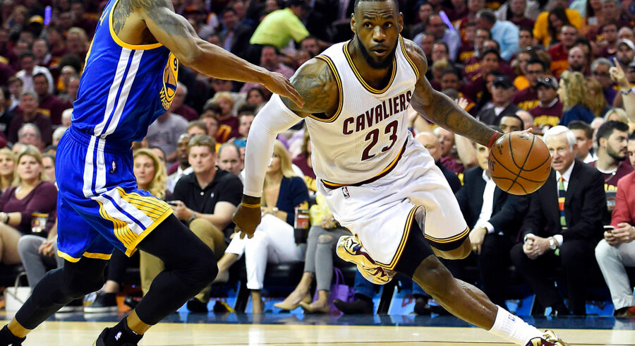 Jun 16, 2015; Cleveland, OH, USA; Cleveland Cavaliers forward LeBron James (23) drives to the basket against Golden State Warriors guard Andre Iguodala (9) during the first quarter in game six of the NBA Finals at Quicken Loans Arena. Mandatory Credit: Bob Donnan-USA TODAY Sports