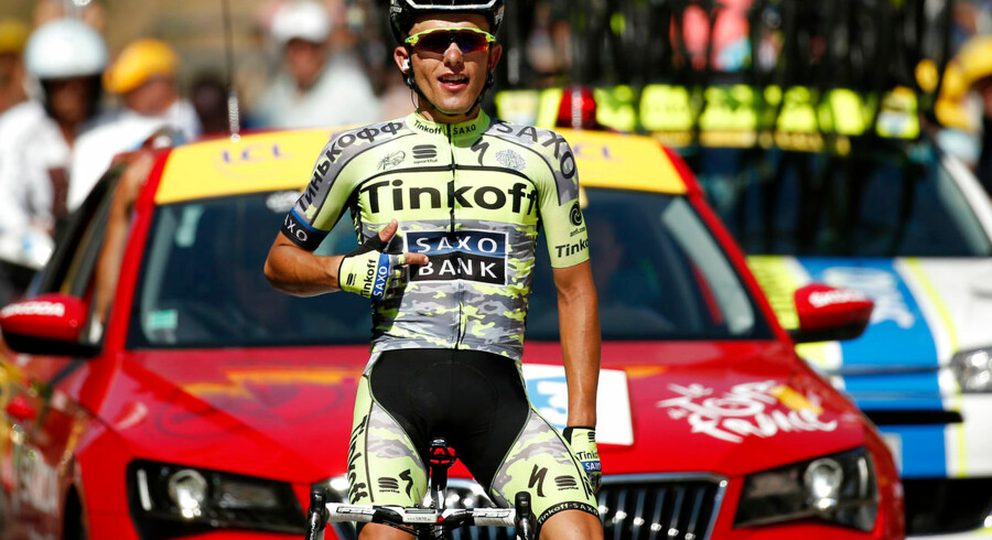Tinkoff-Saxo rider Rafal Majka of Poland celebrates as he crosses the finish line to win the 188-km (116.8 miles) 11th stage of the 102nd Tour de France cycling race from Pau to Cauterets in the French Pyrenees mountains, France, July 15, 2015. REUTERS/Benoit Tessier