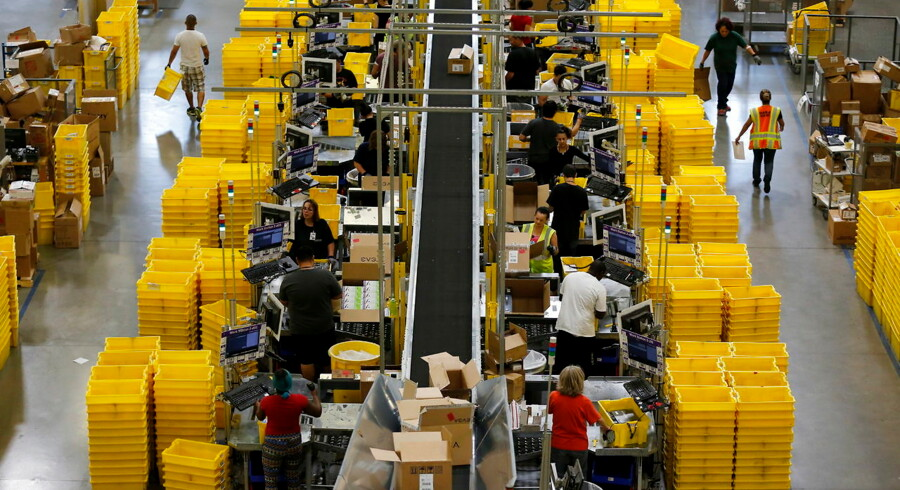 Workers sort arriving products at an Amazon Fulfilment Center in Tracy, California August 3, 2015. REUTERS/Robert Galbraith