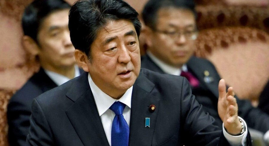 """Japanese Prime Minister Shinzo Abe gestures as he answers questions at a upper house committe of the National Diet in Tokyo on March 6, 2017. Abe said three of the four missiles launched from North Korea landed in Japanese-controlled waters, calling the development a """"new stage of threat"""". / AFP PHOTO / TORU YAMANAKA"""