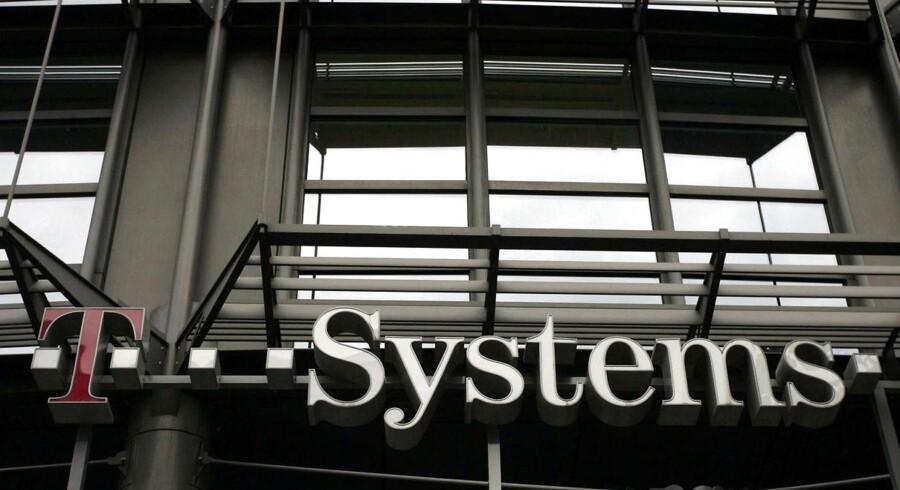 Deutsche Telekoms datterselskab, T-Systems, skal ud i en massiv fyringsrunde. Arkivfoto: Martin Öser, AFP/Scanpix