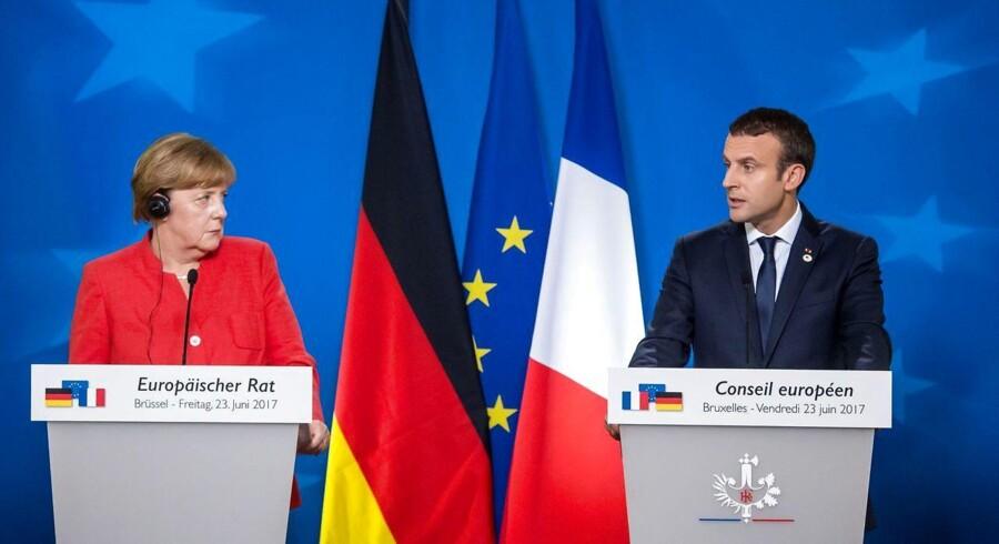 Den tyske kansler, Angela Merkel, og den franske præsident, Emmanuel Macron, holdt fredag fælles pressemøde efter EU-topmødet i Bruxelles. Foto: Aurore Belot/AFP