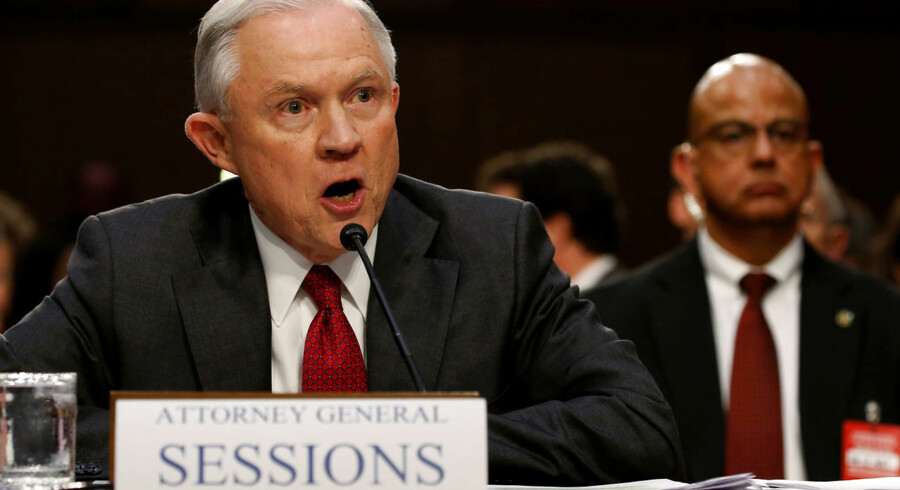 U.S. Attorney General Jeff Sessions reacts angrily to questions from U.S. Senator Ron Wyden (D-OR) as he testifies before a Senate Intelligence Committee hearing on Capitol Hill in Washington, U.S., June 13, 2017. REUTERS/Jonathan Ernst