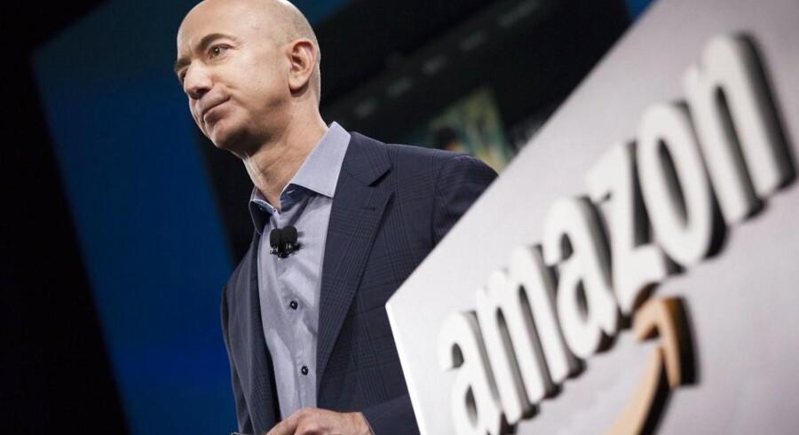 Amazons stifter og topchef, Jeff Bezos, forsøger at få begrænset skaderne af en stærkt kritisk avisartikel om internetgiganten. Arkivfoto: David Ryder, Getty Images/AFP/Scanpix