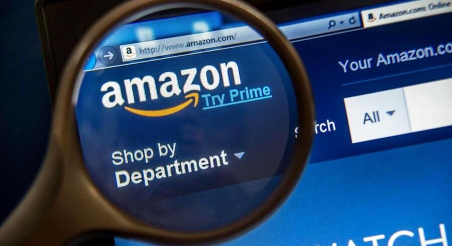 Internetgiganten Amazon har sat sig så grundigt på bogsalget - både de fysiske og de digitale -, at det er blevet et problem. For det kvæler andre boghandeler, lyder det i en klage til det amerikanske justitsministerium fra en bred skare i bogbranchen, som vil have Amazon sat under lup for konkurrenceforvridning. Arkivfoto: Philippe Huguen, AFP/Scanpix