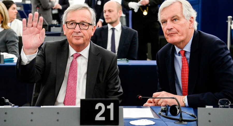"""The President of the European Commission Jean-Claude Juncker (L) gestures next to European commission member in charge of Brexit negotiations with Britain, French Michel Barnier at the European Parliament in Strasbourg, eastern France, on April 5, 2017. The European Parliament will on April 5 lay down its """"red lines"""" for negotiations over a Brexit deal, on which the assembly will have the final say in two years' time. / AFP PHOTO / SEBASTIEN BOZON"""
