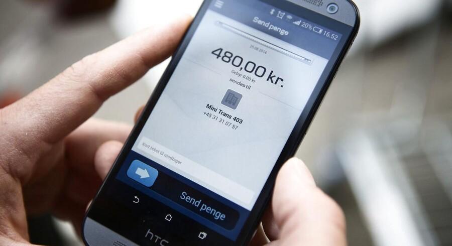 Danske Banks succesrige mobilbetaling, Mobile Pay, får nu ekstra funktioner, og det koster Nets, der står bag dankortet, dyrt på børsen. Arkivfoto: Simon Læssøe, Scanpix