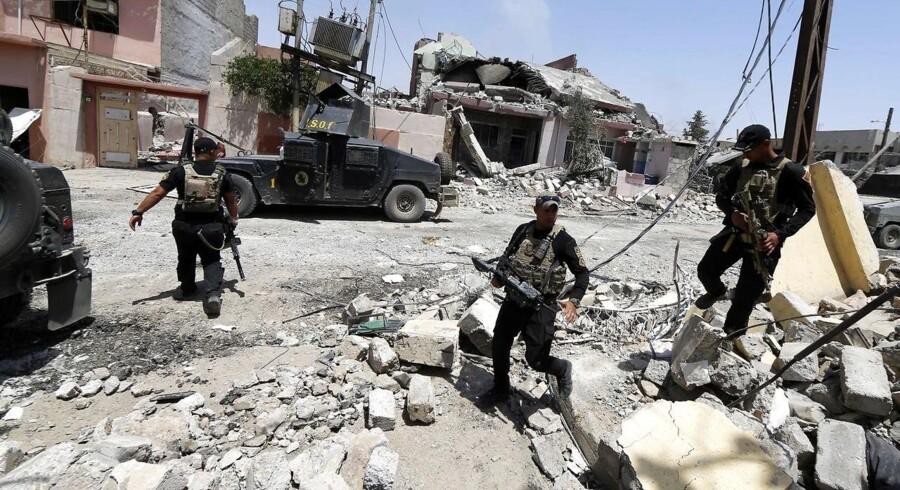 aRKIVFOTO. USA-støttede styrker angriber Raqqa fra nord, øst og vest / AFP PHOTO / KARIM SAHIB