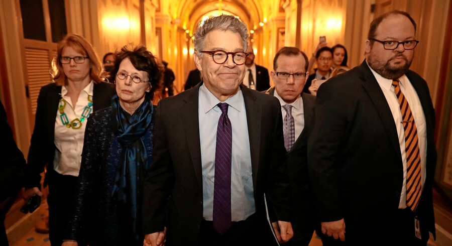 WASHINGTON, DC - DECEMBER 07: Sen. Al Franken (D-MN) (C) and his wife Franni Bryson (L) arrive at the U.S. Capitol Building December 7, 2017 in Washington, DC. Franken announced that he will be resigning in the coming weeks after being accused by several women of sexual harrassment. Chip Somodevilla/Getty Images/AFP == FOR NEWSPAPERS, INTERNET, TELCOS & TELEVISION USE ONLY ==