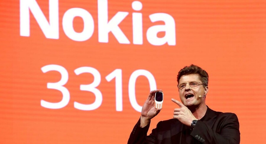 "HMD global CEO Arto Nummela presents his company's new phone ""Nokia 3310"" during a press conference on February 26, 2017 on the eve of the start of the Mobile World Congress. Phone makers will seek to seduce new buyers with even smarter Internet-connected watches and other wireless gadgets as they wrestle for dominance at the world's biggest mobile fair starting tomorrow. / AFP PHOTO / Josep Lago"