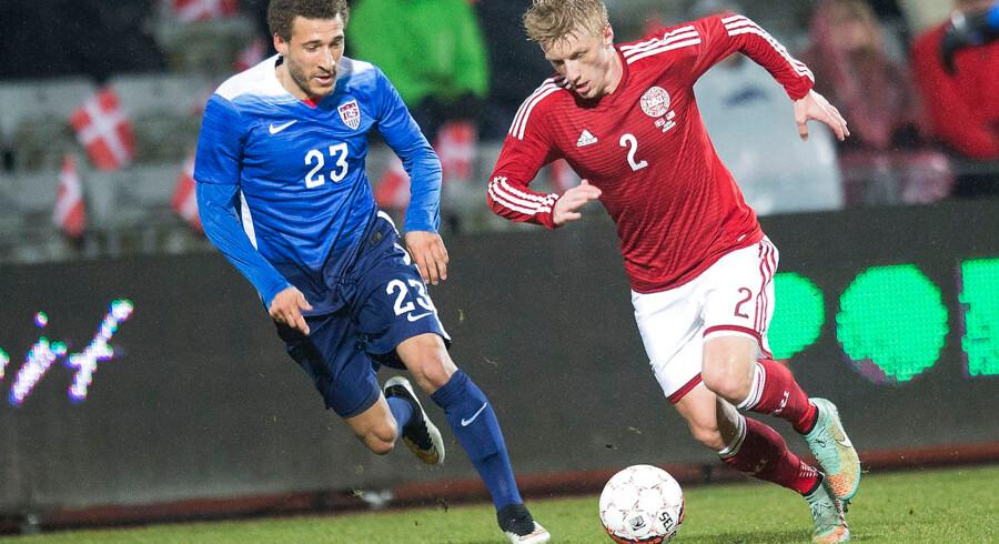 Daniel Wass, der her ses (th) i den danske landsholdsdragt, skifter franske Evian ud med spanske Celta Vigo.