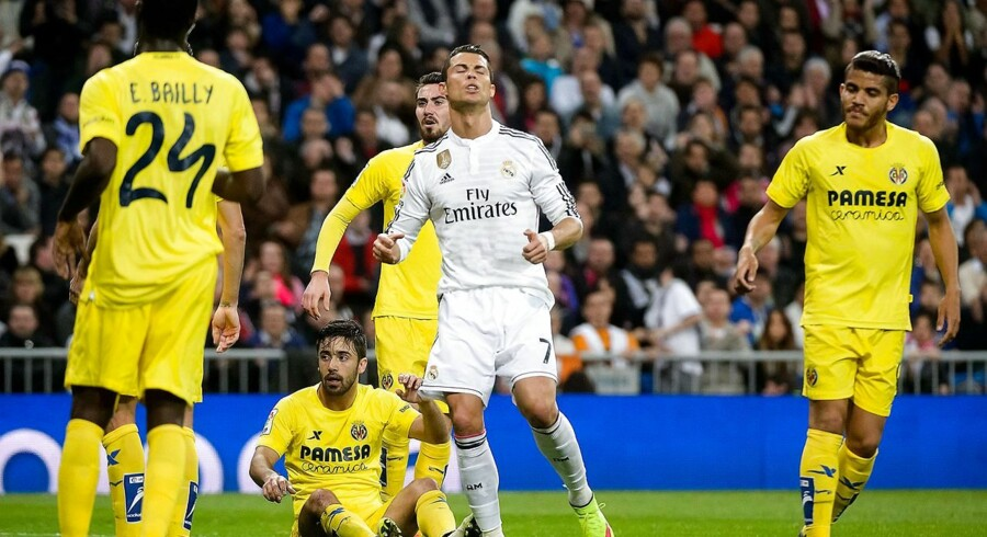 Real Madrid's Portuguese forward Cristiano Ronaldo (C) reacts during the Spanish league football match Real Madrid CF vs Villarreal CF at the Santiago Bernabeu stadium in Madrid on March 1, 2015. The game ended with a draw 1-1. AFP PHOTO/ DANI POZO
