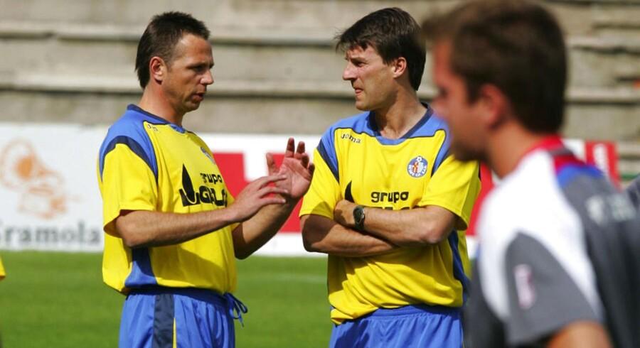 Erik Larsen og Michael Laudrup arbejdede længe sammen, men da Laudrup tog til Qatar, begyndte Erik Larsen at arbejde for AGF. Det samarbejde stopper nu.