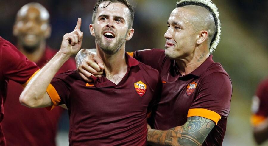 Miralem Pjanic (tv) i aktion for sin nuværende klub, Roma. Arkivfoto.red.
