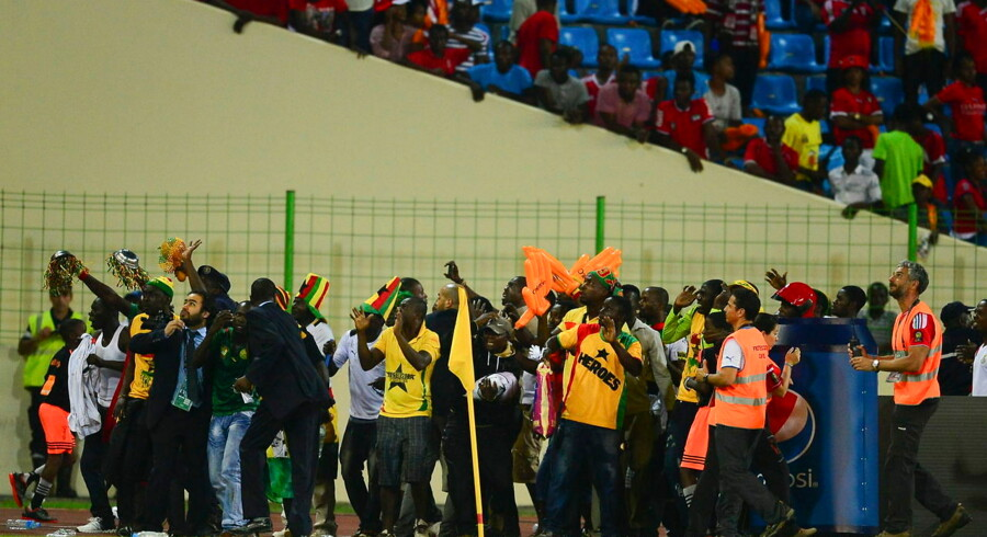 epa04605290 Hundreds of Ghanaian fans invade the pitch to escape projectiles being thrown at them during the 2015 Africa Cup of Nations semi final match between Ghana and Equatorial Guinea at the Malabo Stadium, Malabo, Equatorial Guinea on 05 February 2015. EPA/BARRY ALDWORTH UK AND IRELAND OUT
