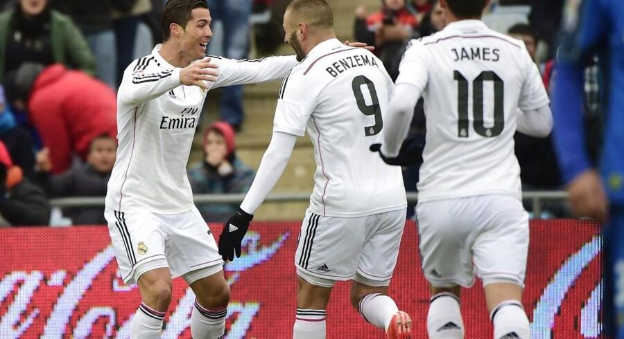 Cristiano Ronaldo fejrer en af sine scoringer mod Getafe sammen med Karim Benzema og en tililende James Rodriquez.
