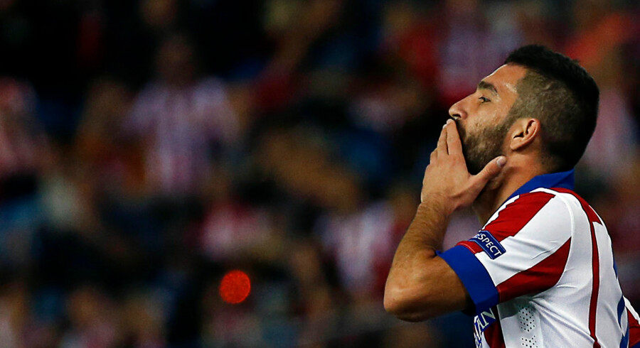 Atletico Madrid's Arda Turan reacts after missing a chance to score against Malmo during their Champions League soccer match at Vicente Calderon stadium in Madrid October 22, 2014. REUTERS/Sergio Perez (SPAIN - Tags: SPORT SOCCER)