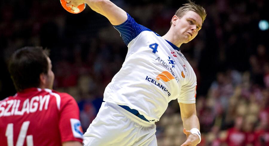 Match between Iceland vs Austria during the Mens Handball European Championship in Herning,   Denmark ,   18. January 2014 . Aron Palmarsson (Iceland - 4) - forground Viktor Szilagyi (Austria 14)