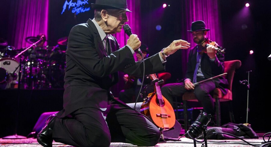 Canadian poet-songwriter Leonard Cohen performs at the Auditorium Stravinski during the 47nd edition of the Montreux Jazz Festival on July 7, 2013. AFP PHOTO / FABRICE COFFRINI