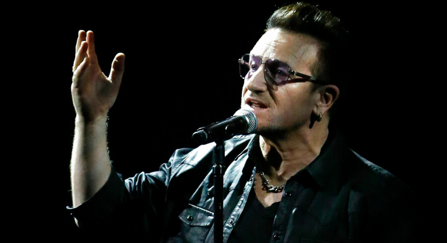 U2 frontman Bono sings during the Bambi 2014 media awards ceremony in Berlin November 13, 2014. The annual Bambi awards honours celebrities from the world of entertainment, literature, sports and politics. REUTERS/Fabrizio Bensch (GERMANY - Tags: ENTERTAINMENT)