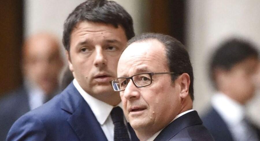Italiens premierminister, Matteo Renzi, og den franske præsident, Francois Hollande (th.) har begge problemer med at overholde EUs budgetkrav. De får nu begge et pusterum indtil marts, inden Kommissionen tager endelig stilling til, om det skal have konsekvenser i form af sanktioner.