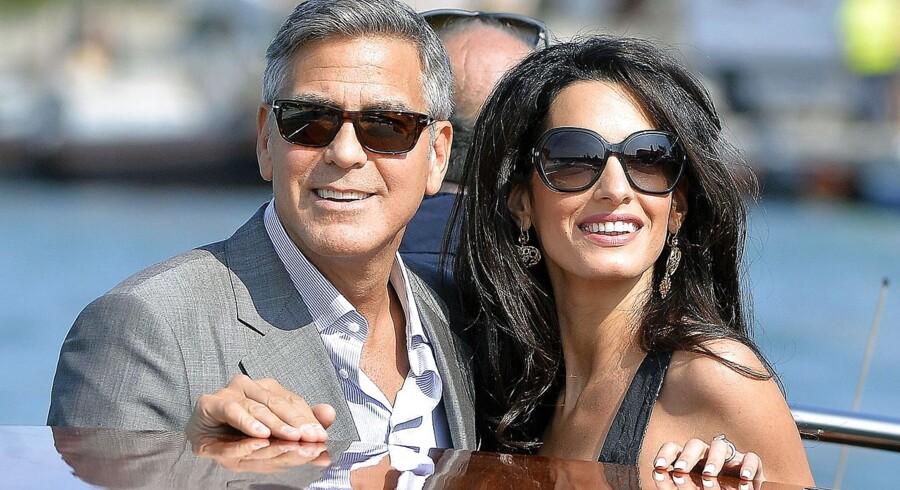 Hollywoodstjernen George Clooney, 53, er i Venedig med den britisk-libanesiske forlovede, advokat Amal Alamuddin, 36, som han siger ja til ved et storstilet kendisbryllup på mandag d. 29. sept. i kanalernes by. AFP PHOTO / ANDREAS SOLARO