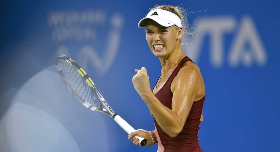 Caroline Wozniacki i aktion under WTA-turneringen Wuhan Open i Kina.