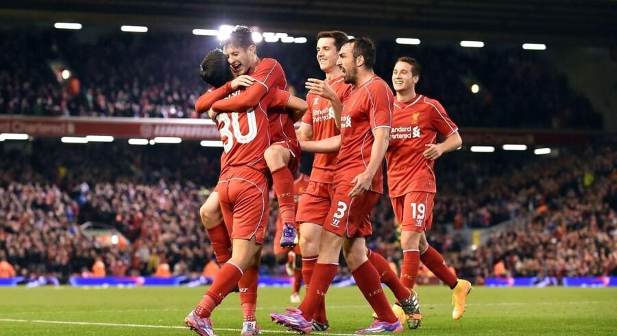 Liverpools spanske midtbanespiller Suso fejrer sin scoring i kampens ekstratid sammen med holdkammeraterne.