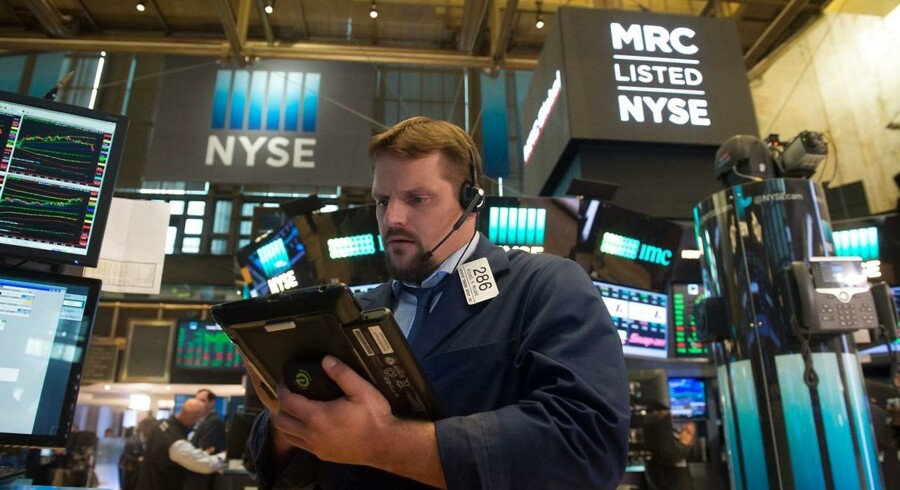 "A trader works on the floor at the closing bell of the Dow Jones Industrial Average at the New York Stock Exchange on August 1, 2017 in New York. Wall Street opened on the upside, with the Dow pushing further higher after having finished Monday at a fourth-straight record high, and nearing breaking through 22, 000 points for the first time ever. ""US stocks are nicely higher in early action, with the global markets reacting positively to the continued mostly upbeat earnings season and favourable manufacturing data out of Europe and Asia, "" said analysts at Charles Schwab brokerage. / AFP PHOTO / Bryan R. Smith"