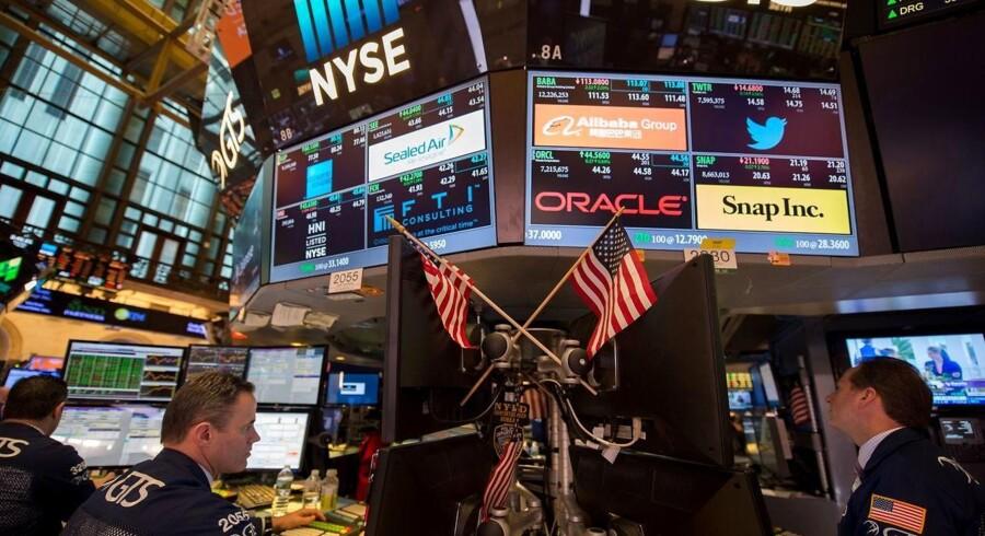 Arkivfoto. De amerikanske aktier endte med en lille pil ned fredag, efter at investorerne ellers havde lagt ud med at løfte de toneangivende indeks i den tidlige handel.