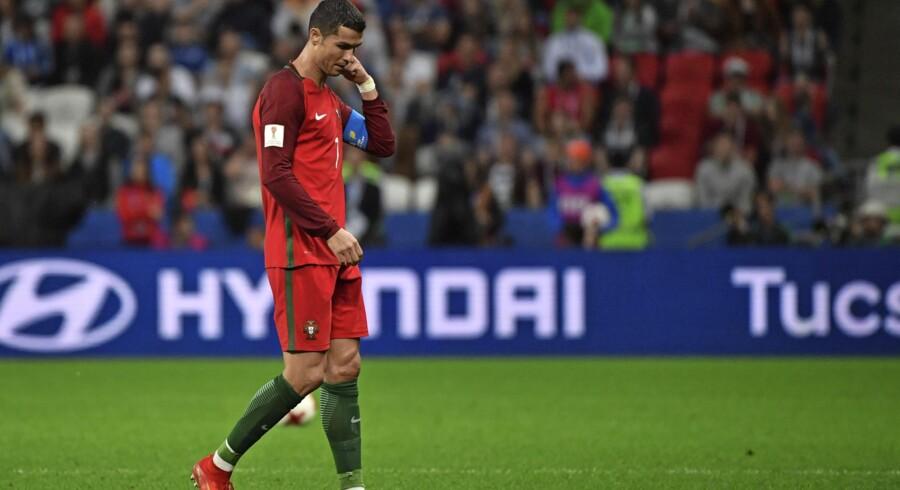 Ronaldo-sagen er ikke alene interessant for fodboldinteresserede. Den har også fangarme ind i dansk erhvervsliv, da en del af Ronaldos sponsorpenge stammer fra tøjproducenten JBS, som har haft et samarbejde med Ronaldo om design af underbukser med mærket CR7. Foto: Yuri Cortez/AFP