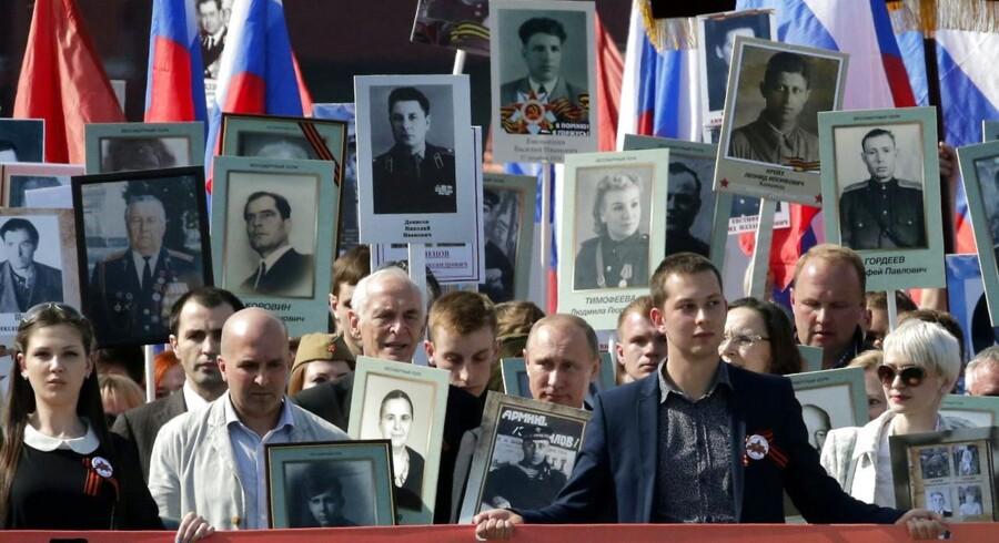 Vladimir Putin på den Røde Plads i Moskva lørdag.