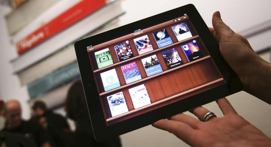 Apples aftale med fem større forlag om priserne på e-bøger i Apples netbutik var ulovlig, og derfor skal folk nu have over to milliarder kroner tilbage. Arkivfoto: Shannon Stapleton, Reuters/Scanpix