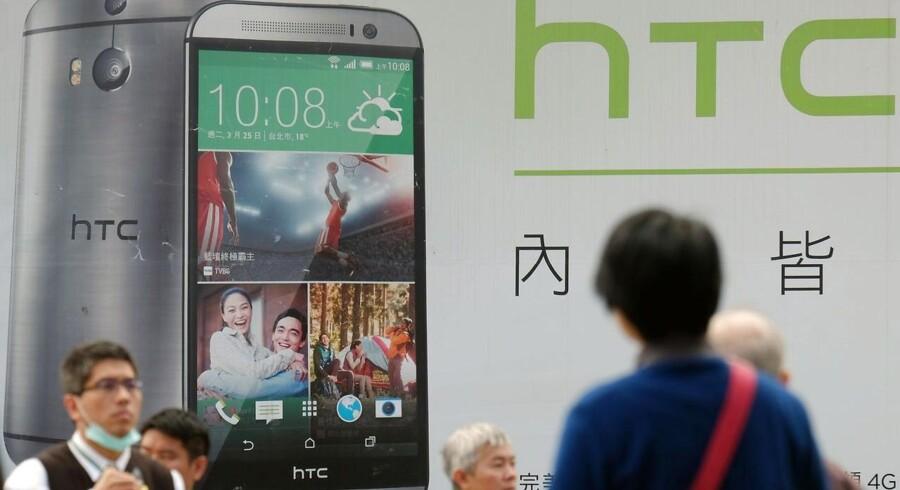 HTC har trods anmelderroste telefoner økonomiske problemer, og aktien er faldet med 60 procent siden nytår. Arkivfoto: Sam Yeg, AFP/Scanpix