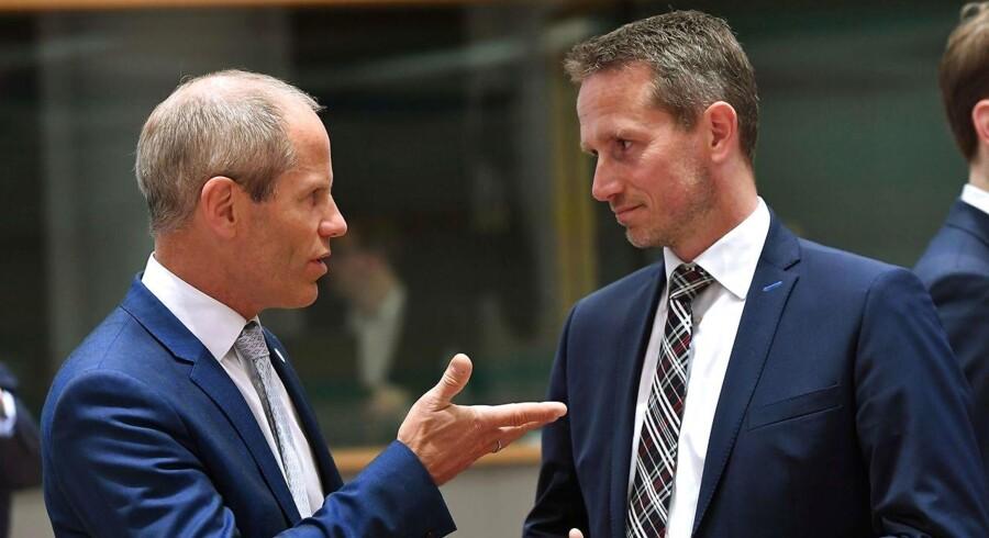 Finansminister Kristian Jensen (V) sammen med Estlands Finansminister Jurgen Ligi (L) til EU's økonomi- og finansministermøde i Bruxelles. 25. maj 2018. / AFP PHOTO / Emmanuel DUNAND