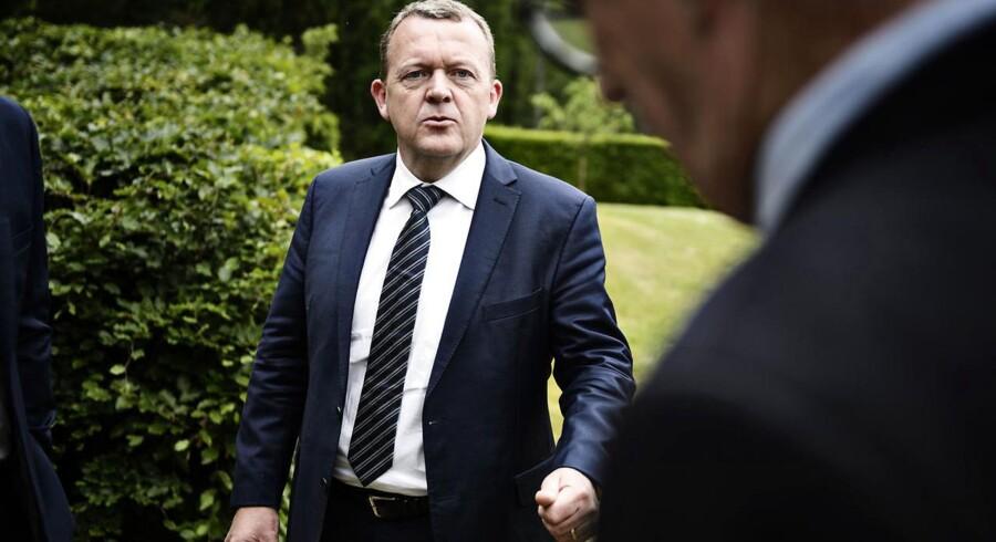 Lars Løkke Rasmussen og regeringen vil hæve skatten, når PSO-afgiften afskaffes.