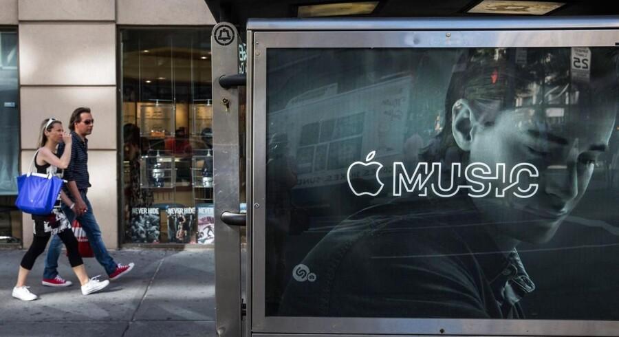 Apple Music har været i søgelyset for konkurrenceforvridning, men EU indstiller nu sine undersøgelser. Arkivfoto: Andrew Burton, Getty Images/AFP/Scanpix